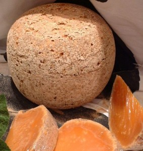 Mimolette is a hard, aged cheese that looks like a cantelope.  Somewhere between Cheddar and Gouda.